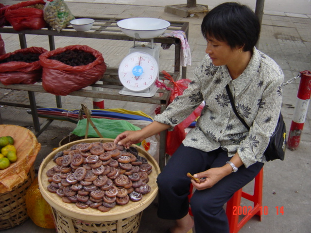 Roadside vendor in Yongtai selling (and eating) dried persimmons.