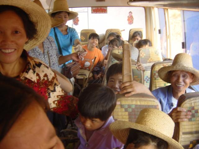 Peasants on bus leaving Wenzhu