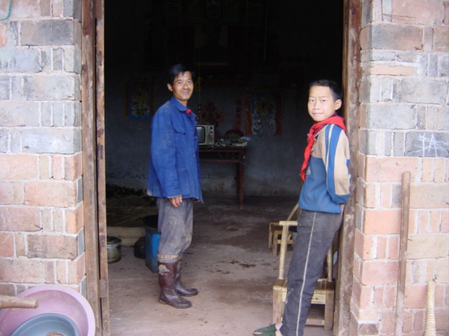 Mr Chen and his son at the confluence, the front door of their house