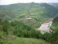 #3: View from 210 metres northwest of the confluence, which is located at the farmhouse on the opposite side of the valley