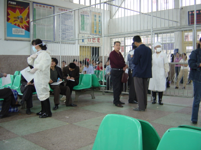 Temperature-taking and form-filling upon arrival at the Pingkou Railway Station--part of the nationwide effort to curb the spread of SARS