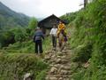 #5: Young girl on horseback, making her way down a stone path into Tielu from somewhere in the surrounding countryside