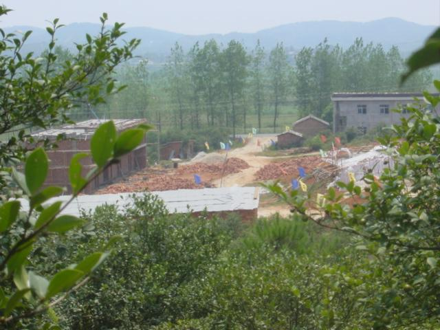 Construction site and road, as seen from hilltop