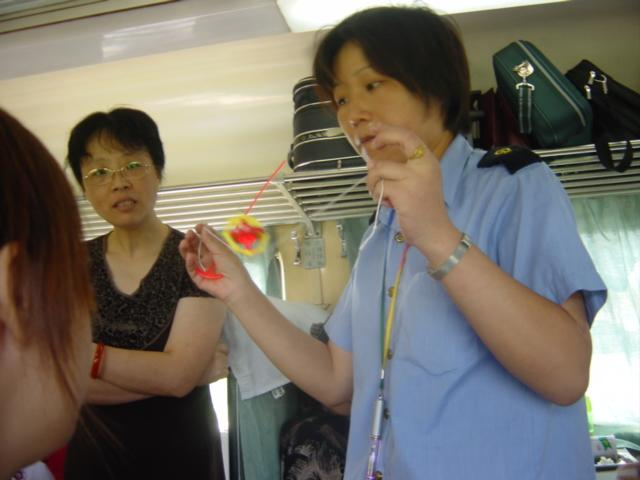 Train conductor balancing gyroscope on string