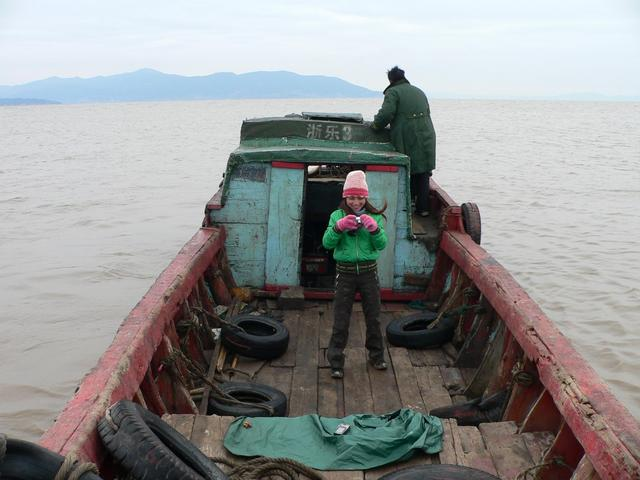 Liu Zifeng on the old wooden boat we chartered