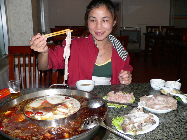 Ah Feng enjoys an extremely spicy, traditional Chóngqìng hotpot dinner on her birthday.
