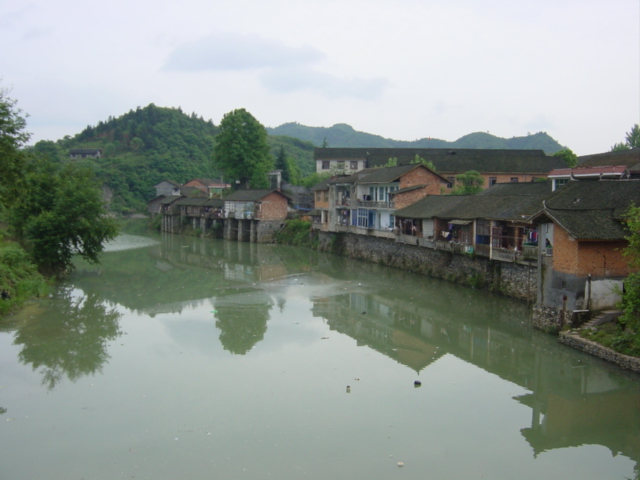 "Picturesque town of Niuchehe (""Ox Cart River""), dominated by the river that flows right through the middle of it"
