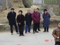 #9: Confluence Point villagers on their way to celebrate Chinese New Year with friends and family