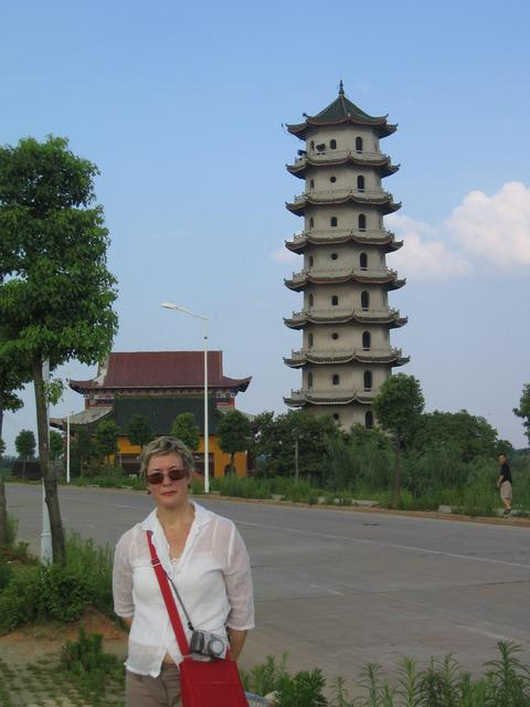 Carmen in front of Daye's tall pagoda.
