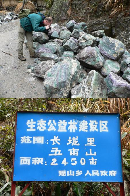 A picture of Tim taking a picture of the coloured quartz from the mines. The signpost marking where the path departs the dirt road.