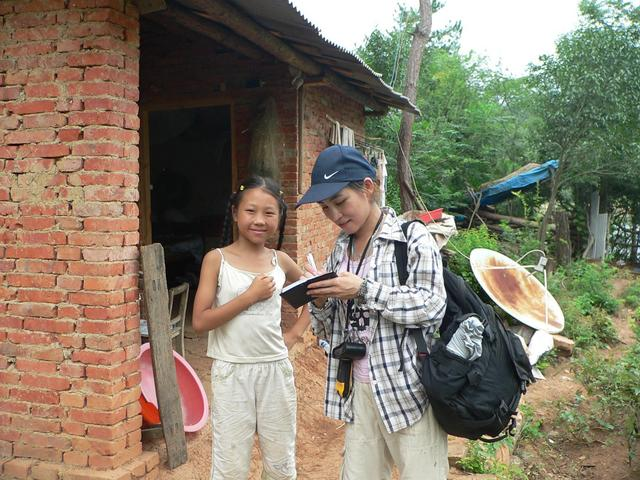 Ah Feng and 10-year-old girl at farmhouse 225 metres NE of confluence.