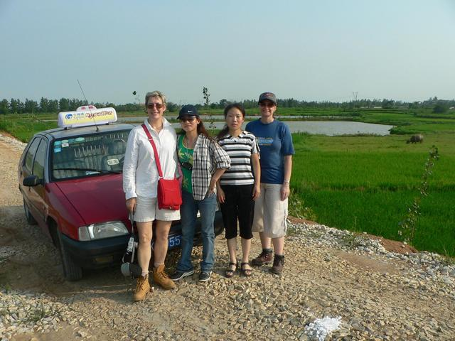 Left to right: Carmen, Ah Feng, our taxi driver and Sasha, on the dirt road 180 metres from the confluence.