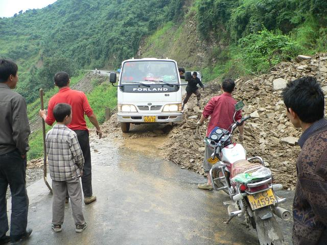 Truck negotiating a landslide on road from Zhushan to Guandu.