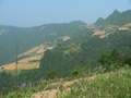 #4: The dirt road ran along the southern slope of a mountain range. Looking SW towards the confluence 1.72 km away.