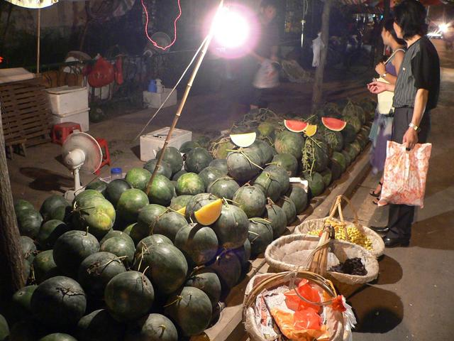 Red and yellow watermelons at Hefei street stall.