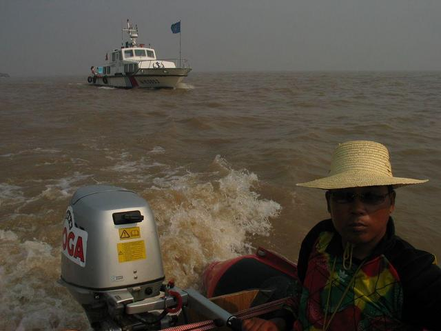 View northwest, upstream. MSA boat and our raft pilot, He Jian Qiang.