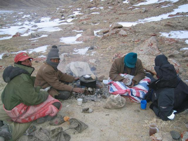 Buju, Sola, Taishi, Robert (left to right) shivering and making tsampa at U-valley cold campsite.