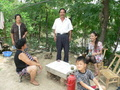 #10: Ah Feng with Mrs Zhèng's mother, Mrs Zhèng (seated), Mr Liú and their son