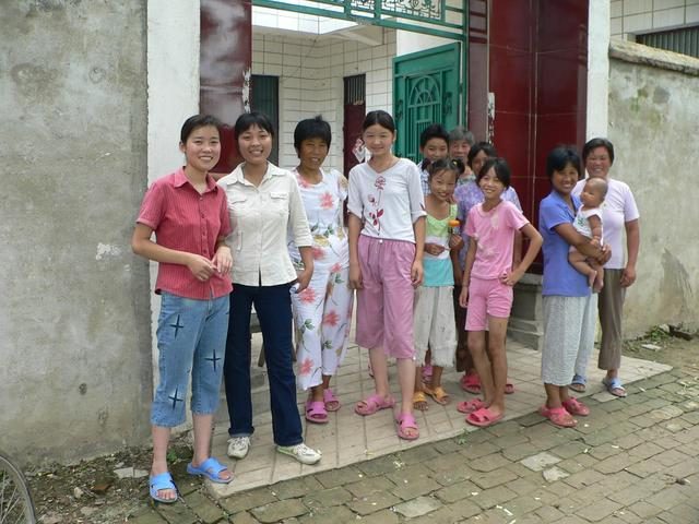 Han Xiaohua (second from left) and others out front of her home in Hanpozhai Village.