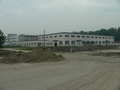 #3: Jiāngsū Zhōnghuì Metal Manufacturing Company Limited on the southeast corner of the intersection near the confluence