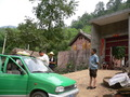 #3: Our taxi and driver in Dàzhuāng Village, attracting some curious locals