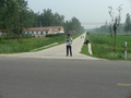 #4: Ah Feng at the start of Húzhuāng Road