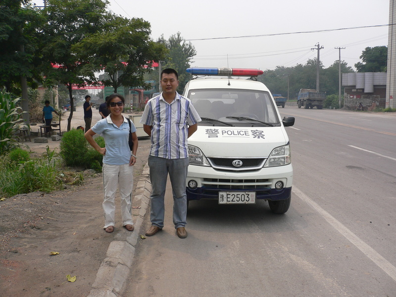 Ah Feng with our police escort at the side of the main highway