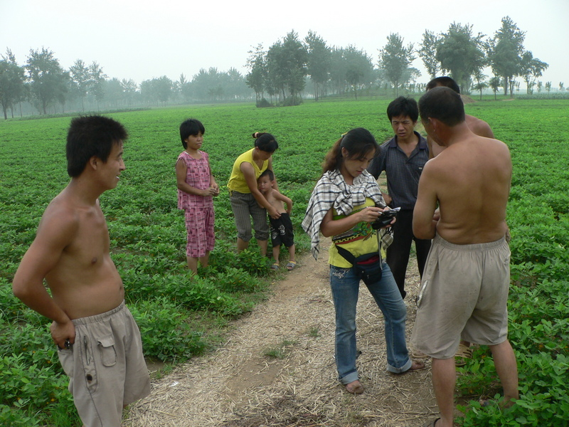 The locals telling Ah Feng the name of the nearby village