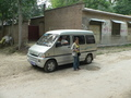 #4: Ah Feng next to our minivan, one block west of the confluence