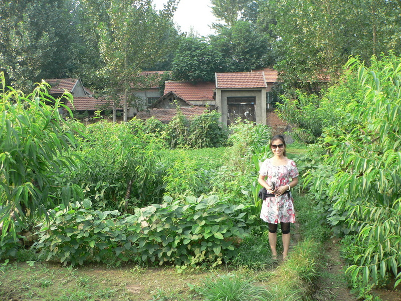 Ah Feng in front of Dìyúgōu Village