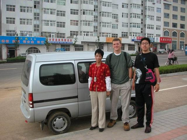 Minivan taxi we rode in, the intrepid driver, myself and my new Chinese friend Pink
