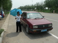 #5: Ah Feng beside our air-conditioned taxi