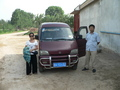 #3: Ah Feng and our driver, next to the minivan in Hābāgōu Village