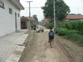 #3: Ah Feng walking through the residential area