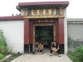 #4: Residents relaxing out front of an ornate doorway
