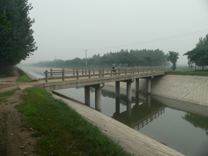Ah Feng crossing a canal, 1 km from the confluence