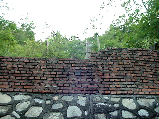 The retaining wall and barbed wire