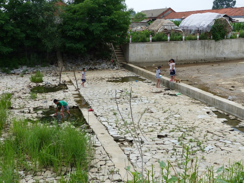 Children playing below the weir