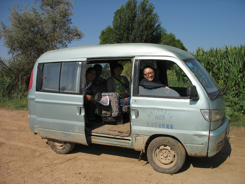 Team members in mini-van which we rented from a local farmer