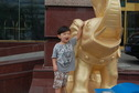 #2: Andy with one of the golden elephants in front of the hotel