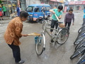 #9: Women cleaning my bicycle