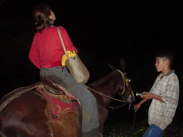 Felipe guiding Maria Eugenia, who is riding the mule