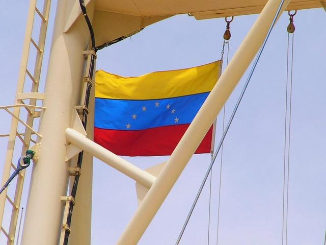 The Venezuelan courtesy flag hoisted
