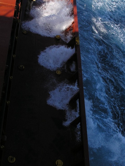 Breakers splashing on the ship's main deck