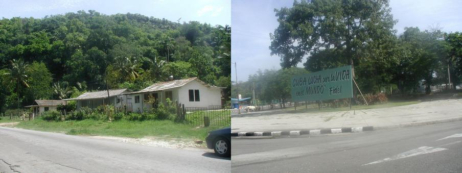 Houses a few kilometers away with rock outcroppings in the background; a typical sign along the road leaving Habana.