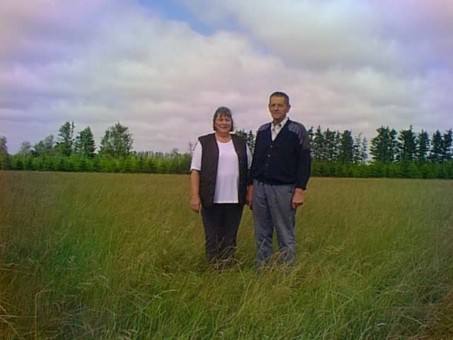 Looking north at Mr.and Mrs. Nygaard standing on the confluence, located on one of their fields.