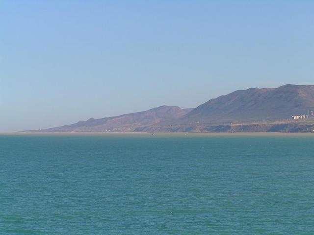 View ENE - The coast around Cap Ouillis seen from the Confluence