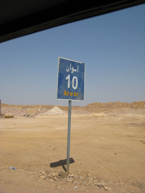 Road sign showing the distance back to Aswān