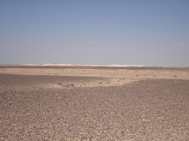 View of general area taken from asphalt road looking in a NNW direction. Confluence lies approx. 8 km towards left of image