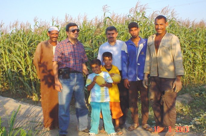 Group photo, from right to left, farmer, farmer, Ahmad, Adam, Ibrahim, Omar, and farmer. Photo by Ghada.